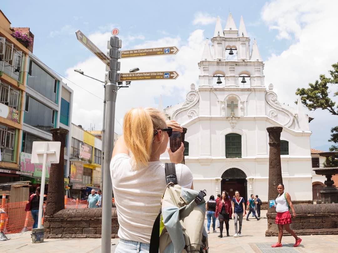 Taking a photo of a church in el centro, medellin