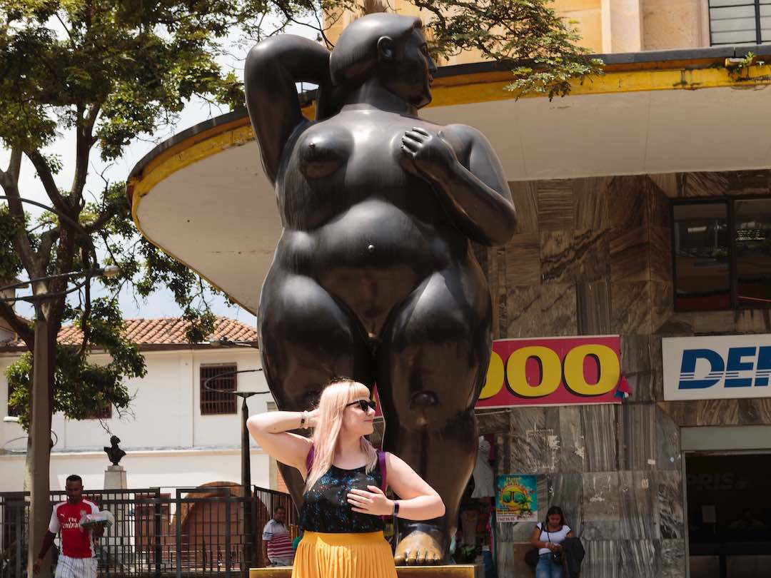 Admiring the botero statues in Colombia