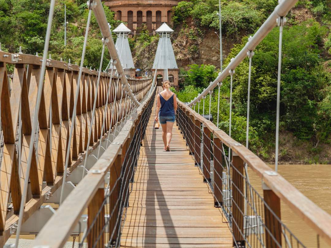 Walking across the puente occidente, colombia