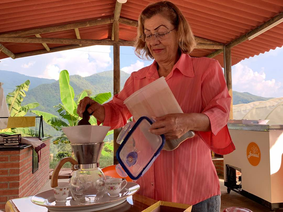 Colombian coffee farmer preparing fresh coffee