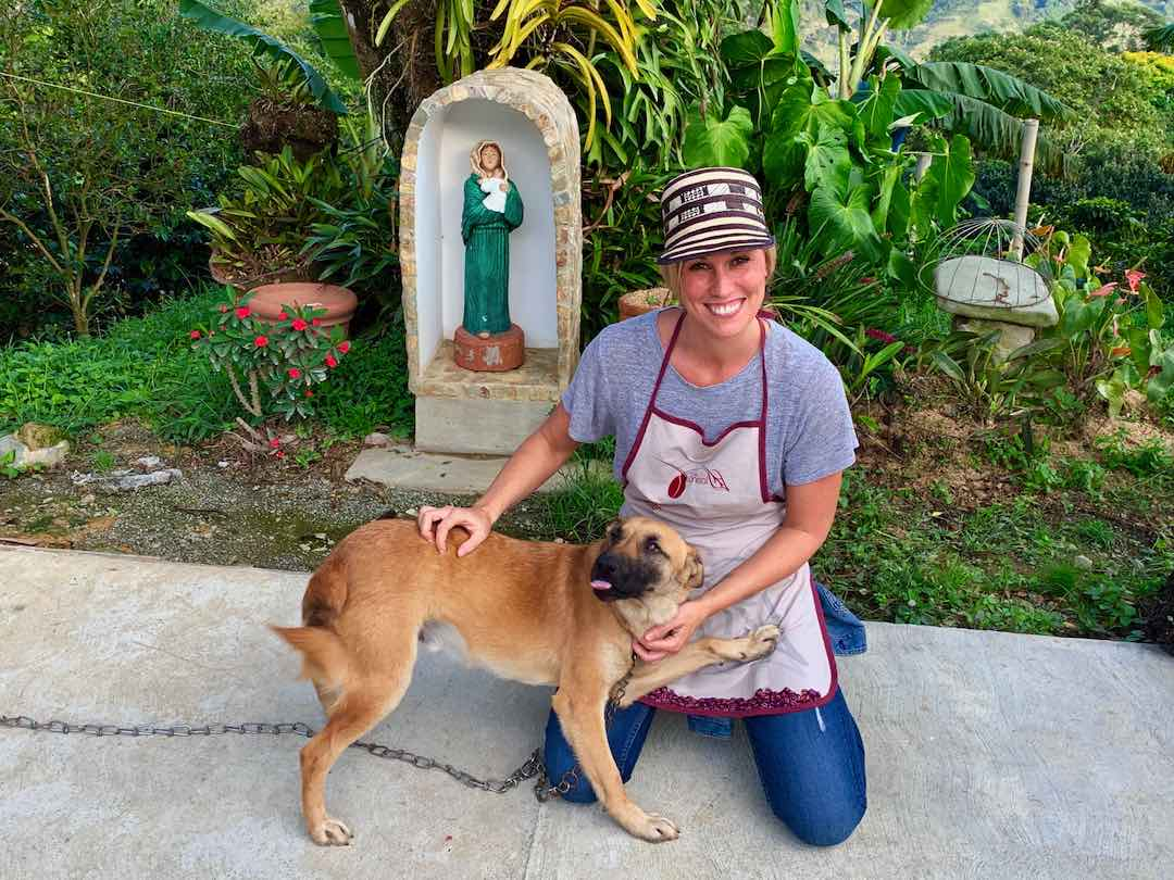 Playing with dog in Colombia's coffee region