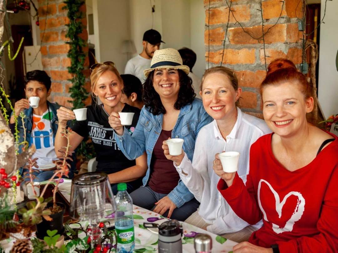 Drinking Colombian coffee with Other Way Round tour group guests