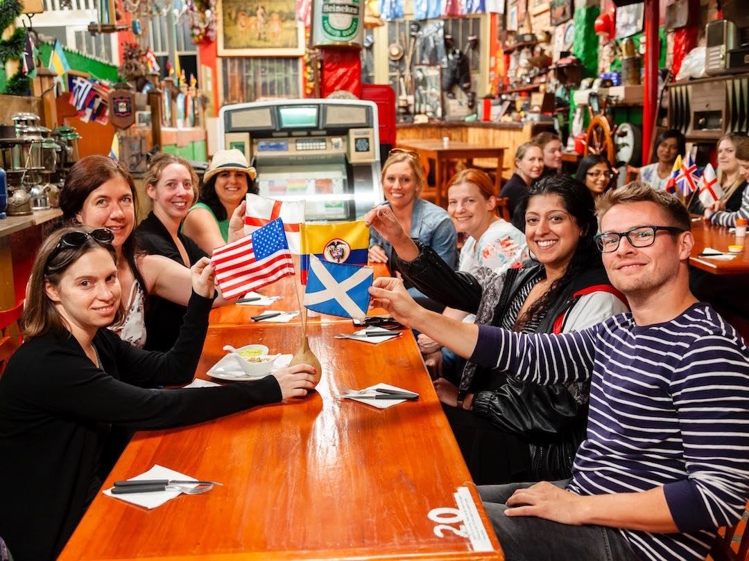 30-40 travel tour enjoying meal in Colombia