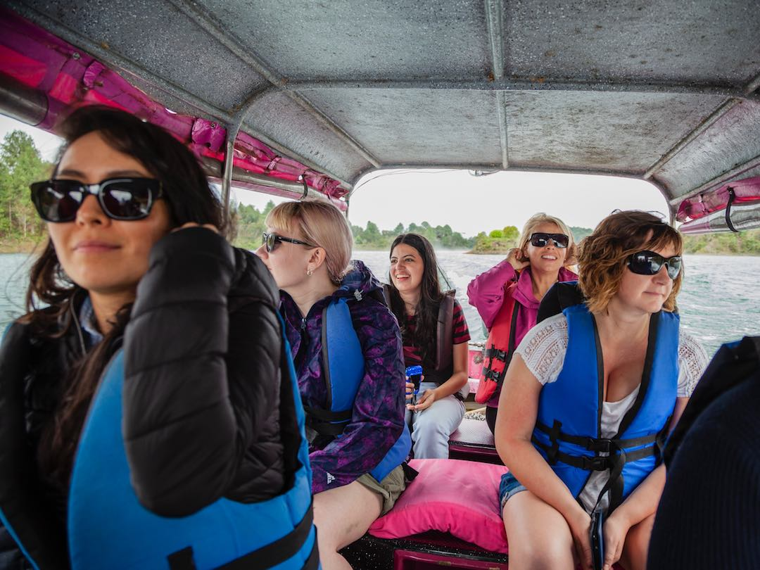 Solo travel group sailing down the amazon in Peru