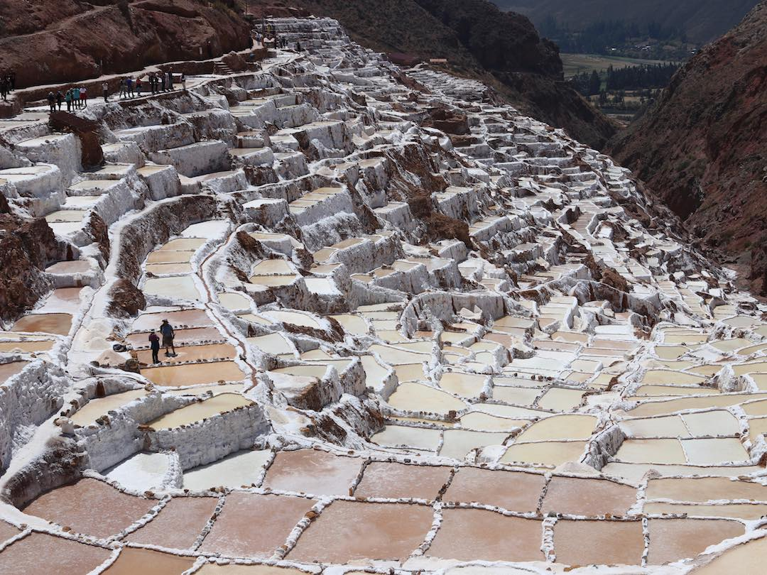 Other Way Round tour group visiting salt mines of maras in Peru