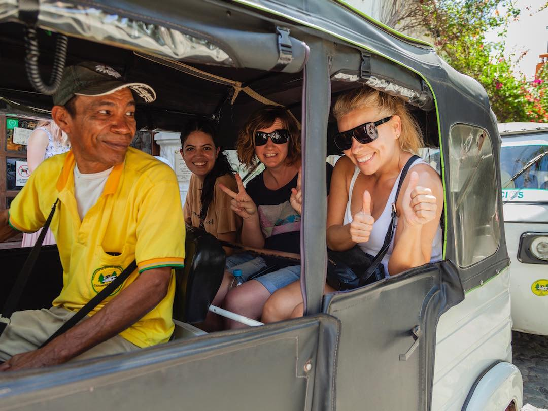 Riding tuk tuk during Colombia small group tour