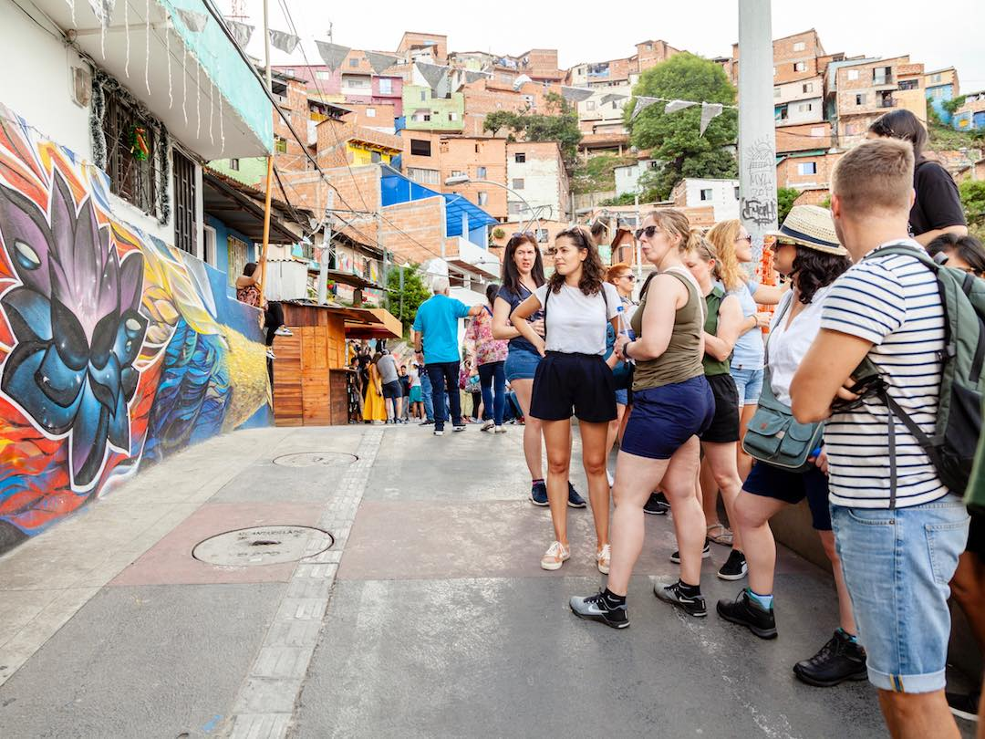 Tour guide speaking in comuna 13 medellin during Other Way Round Colombia tour