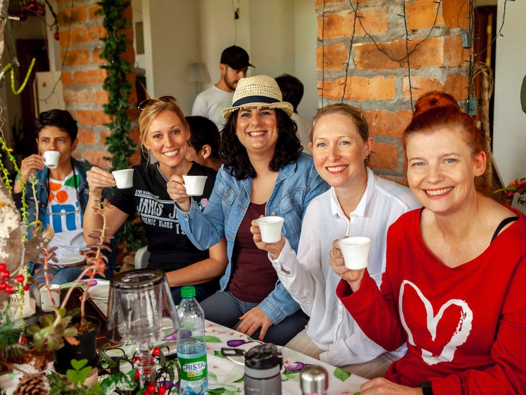 Group of travellers tasting fresh coffee during a Colombia group tour with Other Way Round