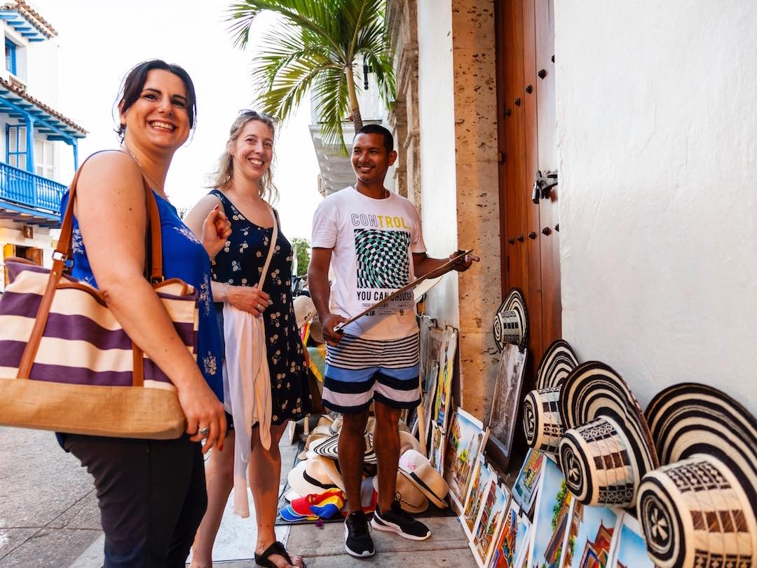 Meeting street vendors during a group trip to Colombia