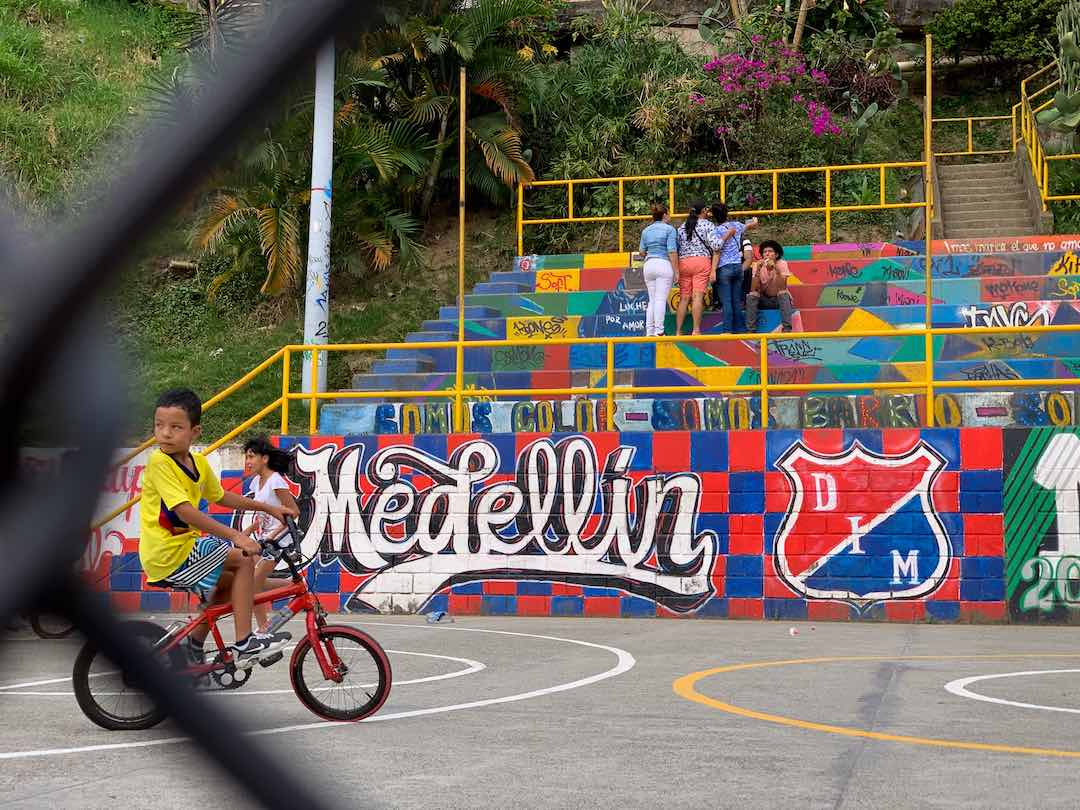 Local kids in Medellin, Colombia during our small group tour