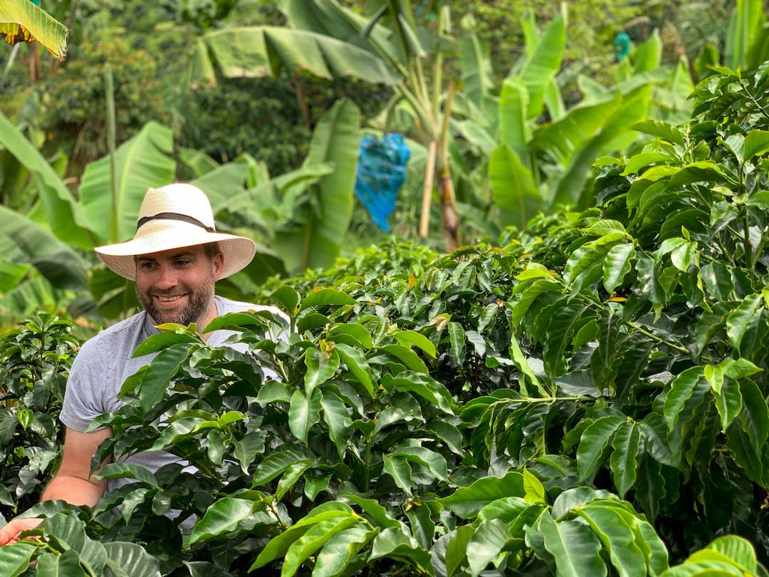 Solo traveller in coffee farm during group tour of colombia
