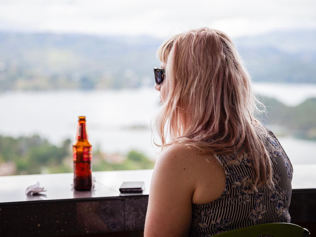 enjoying a beer in guatape colombia
