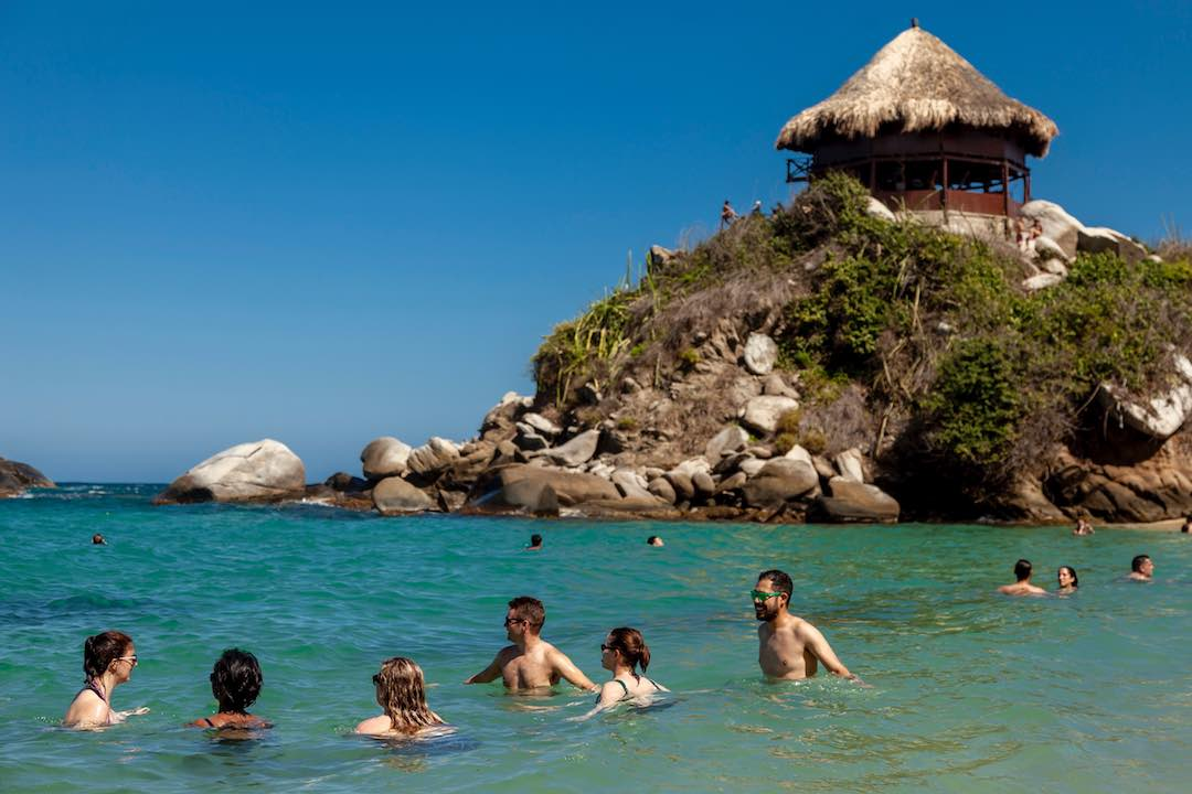 relaxing in cabo san juan beach parque tayrona colombia