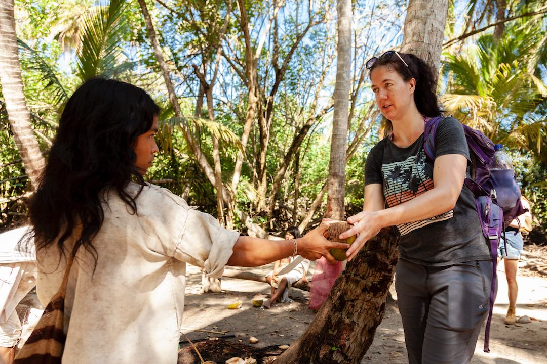 buying coconuts from kogi indigenous community in parque tayrona colombia