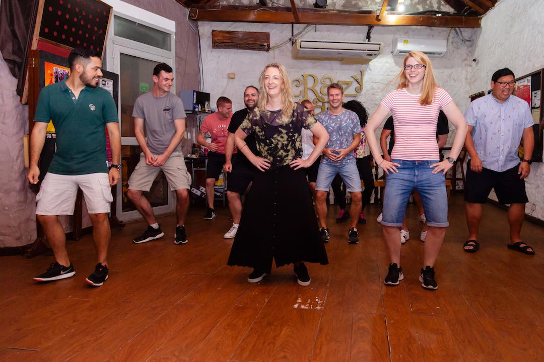 dancing with friends on a group tour