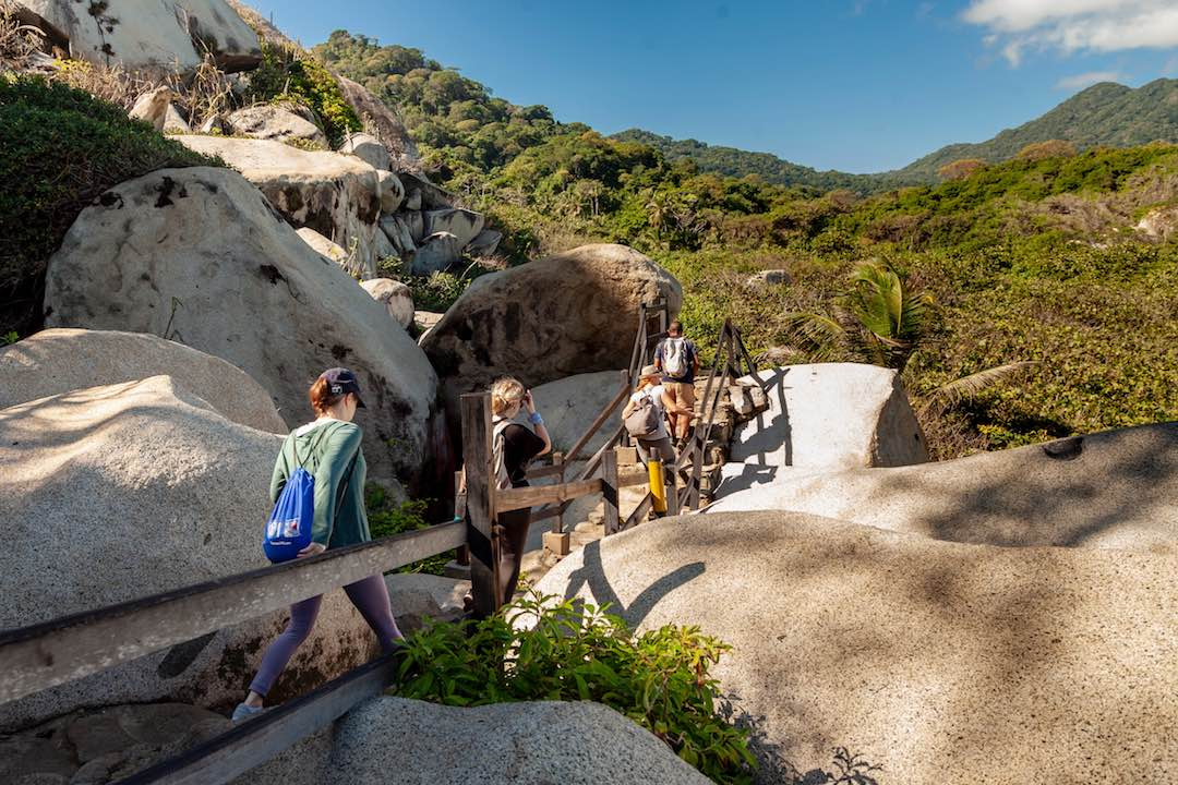 small group enjoying one of the best hikes in colombia through parque tayrona