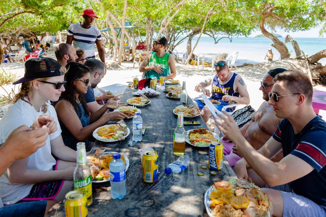 Group of solo travellers enjoying lunch on a group tour